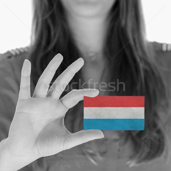 Vrouw tonen visitekaartje vlag Luxemburg ruimte Stockfoto © michaklootwijk