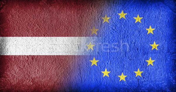 Letland eu vlaggen geschilderd gebarsten beton Stockfoto © michaklootwijk