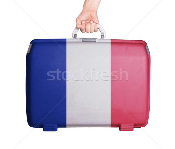 Używany plastikowe walizkę wydrukowane banderą Zdjęcia stock © michaklootwijk