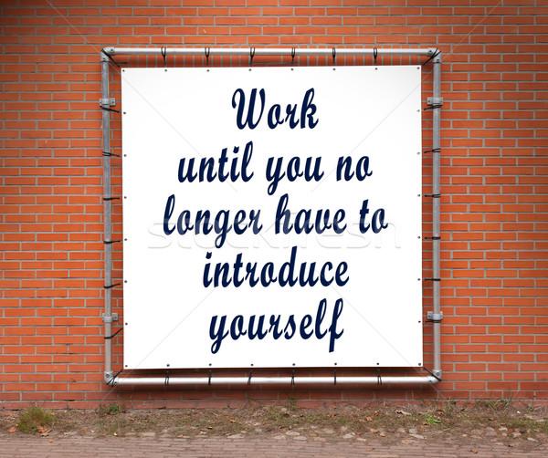 Nagy szalag inspiráló idézet téglafal munka Stock fotó © michaklootwijk