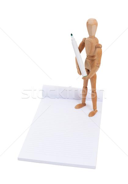 Houten etalagepop schrijven plakboek geïsoleerd papier Stockfoto © michaklootwijk