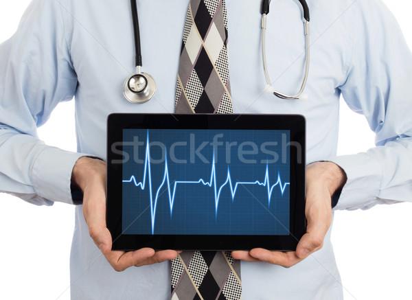 Orvos tart tabletta szívdobbanás grafikon izolált Stock fotó © michaklootwijk