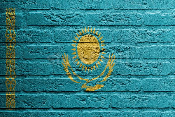 Parede de tijolos pintura bandeira Cazaquistão isolado edifício Foto stock © michaklootwijk