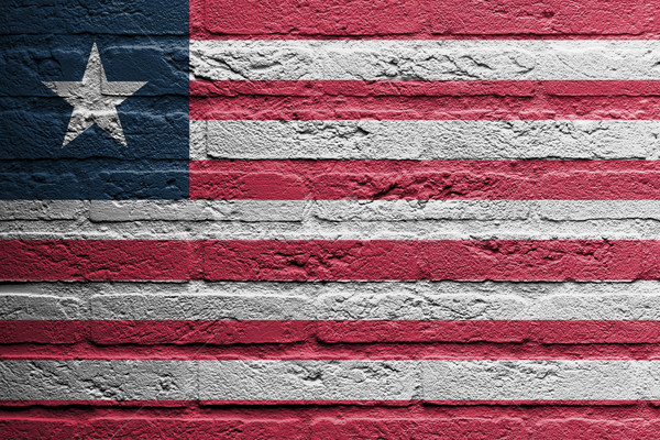 Brick wall with a painting of a flag, Liberia Stock photo © michaklootwijk