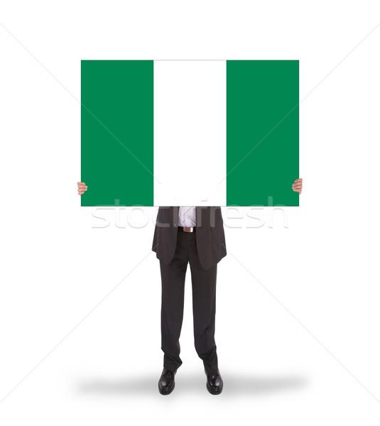 Empresário grande cartão bandeira Nigéria Foto stock © michaklootwijk
