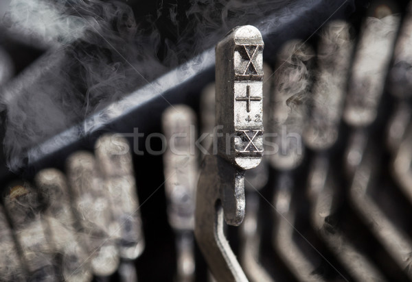 X hammer - old manual typewriter - mystery smoke Stock photo © michaklootwijk