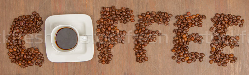 The word Coffee spelled with hundreds of coffee beans and one cu Stock photo © michaklootwijk
