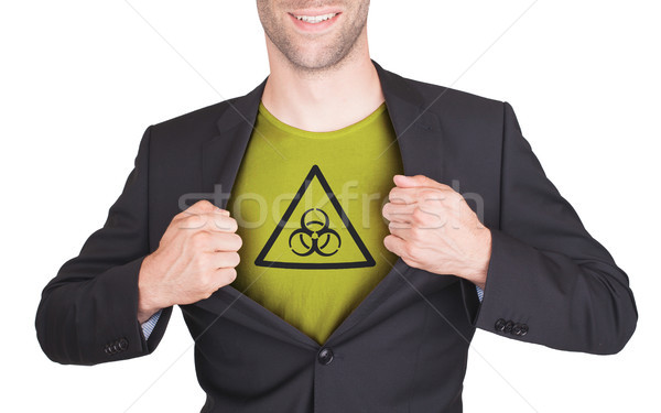 Businessman opening suit to reveal shirt with symbol Stock photo © michaklootwijk