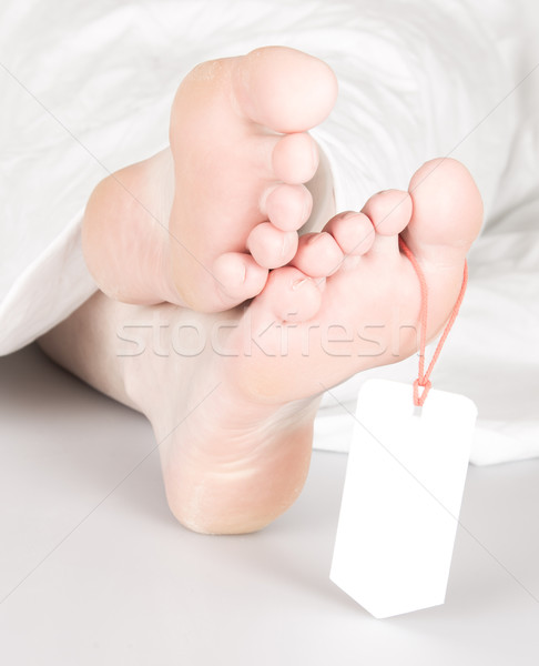 Relaxed dead body with toe tag Stock photo © michaklootwijk