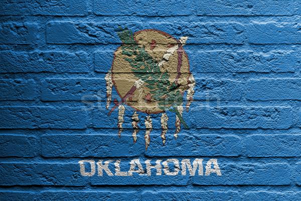 кирпичная стена Живопись флаг Оклахома изолированный краской Сток-фото © michaklootwijk