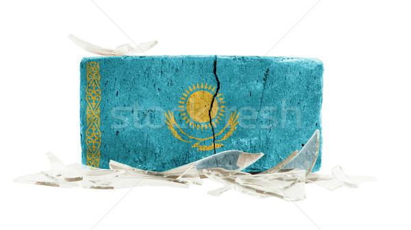 ストックフォト: レンガ · 割れたガラス · 暴力 · フラグ · カザフスタン · 壁