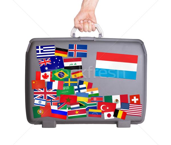 Gebruikt plastic koffer stickers klein groot Stockfoto © michaklootwijk