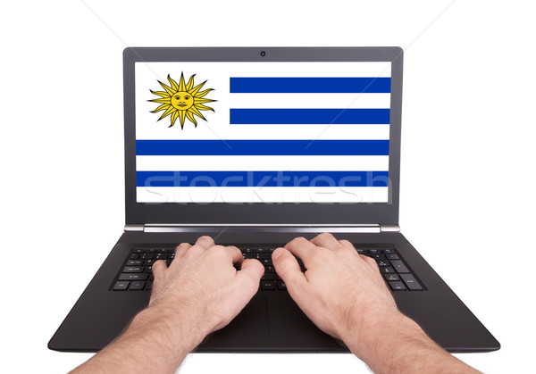 рук рабочих ноутбука Уругвай экране Сток-фото © michaklootwijk