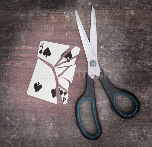 Concept of addiction, card with scissors Stock photo © michaklootwijk