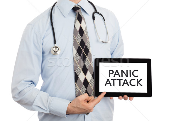 Doctor holding tablet - Panic attack Stock photo © michaklootwijk