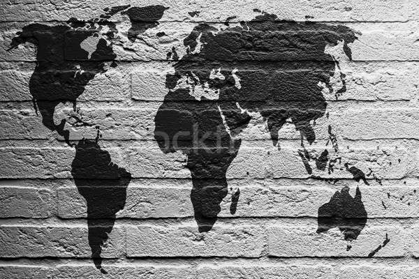 Brick wall with a painting of a flag, World Map Stock photo © michaklootwijk