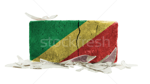Stockfoto: Baksteen · gebroken · glas · geweld · vlag · Congo · muur