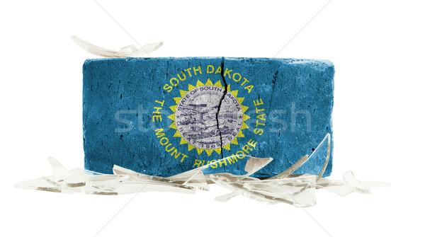 Baksteen gebroken glas geweld vlag South Dakota muur Stockfoto © michaklootwijk