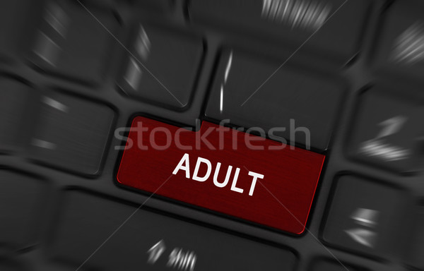 Stock photo: Pressing porn button on a computer keyboard