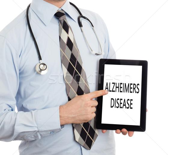 Orvos tart tabletta Alzheimer-kór izolált fehér Stock fotó © michaklootwijk