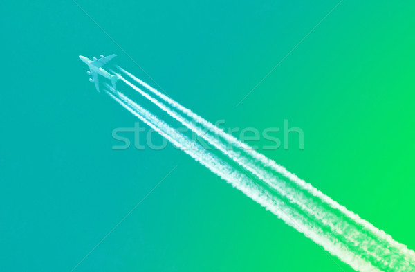 Plane in blue sky - Bright green sky Stock photo © michaklootwijk