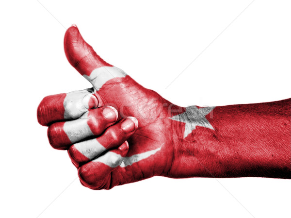 Old woman with arthritis giving the thumbs up sign, wrapped in f Stock photo © michaklootwijk