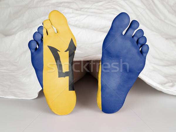 Voeten vlag slapen dood Barbados vrouw Stockfoto © michaklootwijk