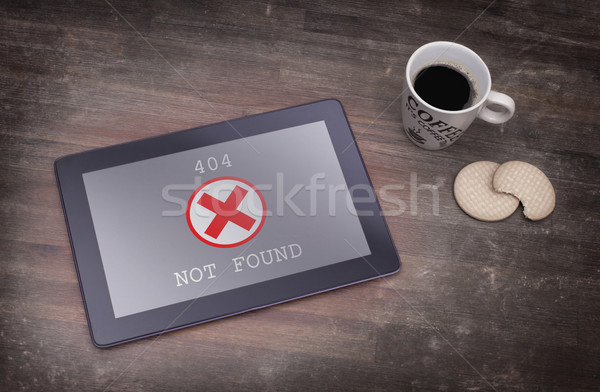 Tablet displaying an error, 404 Stock photo © michaklootwijk