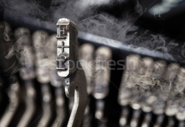 F hammer - old manual typewriter - mystery smoke Stock photo © michaklootwijk