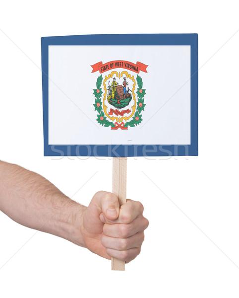 Kéz tart kicsi kártya zászló Nyugat-Virginia Stock fotó © michaklootwijk