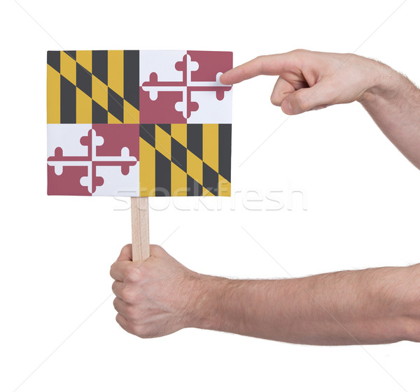 Hand holding small card - Flag of Maryland Stock photo © michaklootwijk