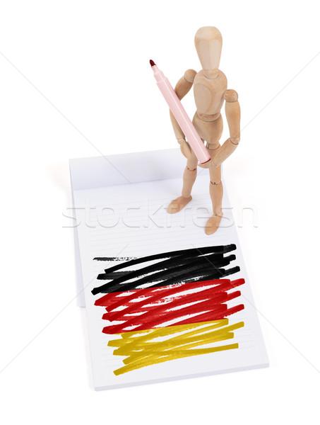Ahşap manken çizim Almanya bayrak kâğıt Stok fotoğraf © michaklootwijk