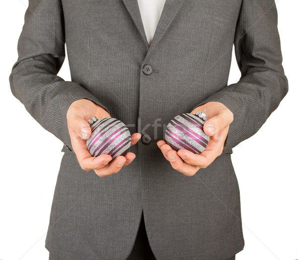 Man in grey suit is holding Christmass balls Stock photo © michaklootwijk