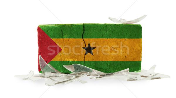 Stockfoto: Baksteen · gebroken · glas · geweld · vlag · muur · glas