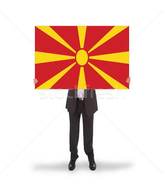Businessman holding a big card, flag of Macedonia Stock photo © michaklootwijk