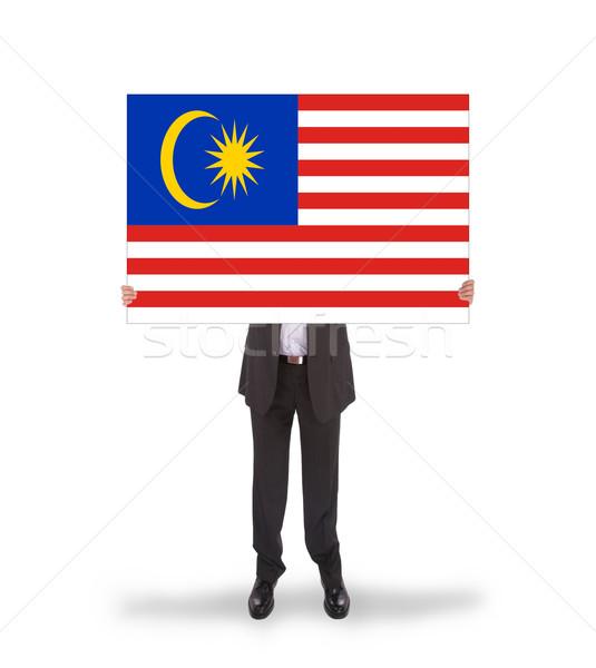 Businessman holding a big card, flag of Malaysia Stock photo © michaklootwijk