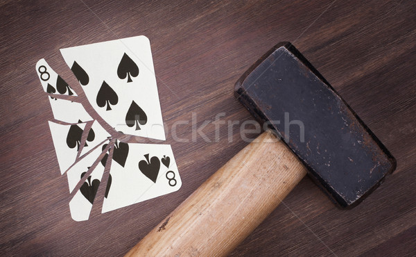 Hammer with a broken card, eight of spades Stock photo © michaklootwijk