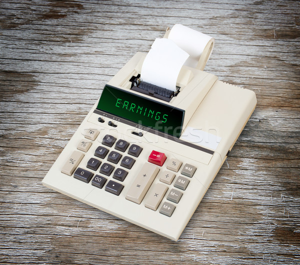 Stock photo: Old calculator - earnings