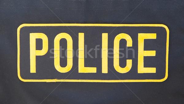 назад полиции пальто знак службе Сток-фото © michaklootwijk