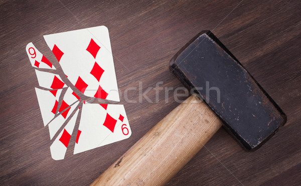 Hammer with a broken card, nine of diamond Stock photo © michaklootwijk