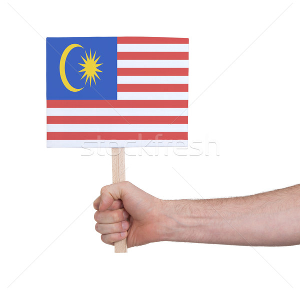 Hand holding small card - Flag of Malaysia Stock photo © michaklootwijk