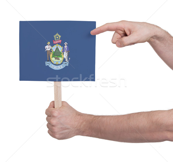 Hand holding small card - Flag of Maine Stock photo © michaklootwijk