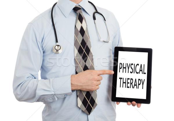 Arts tablet fysiotherapie geïsoleerd witte Stockfoto © michaklootwijk
