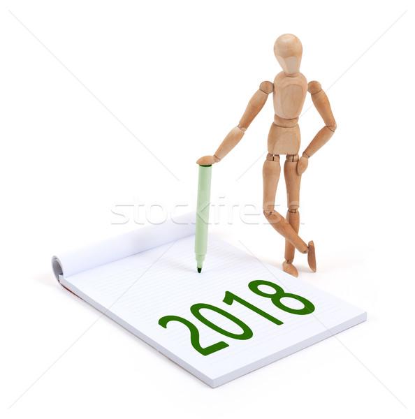 Wooden mannequin writing - 2018 Stock photo © michaklootwijk