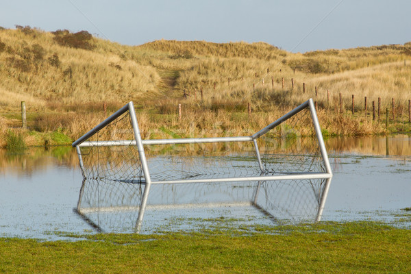 Football goal in a flooded field Stock photo © michaklootwijk