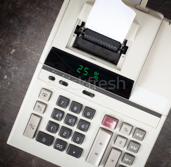 Old calculator showing a percentage - 25 percent Stock photo © michaklootwijk