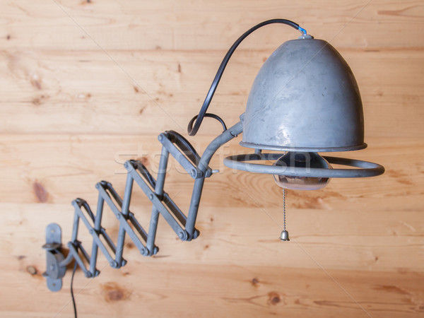Old electric lamp, harmonica, on a wooden wall, Switzerland Stock photo © michaklootwijk