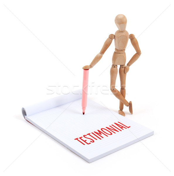 Wooden mannequin writing - Testimonial Stock photo © michaklootwijk