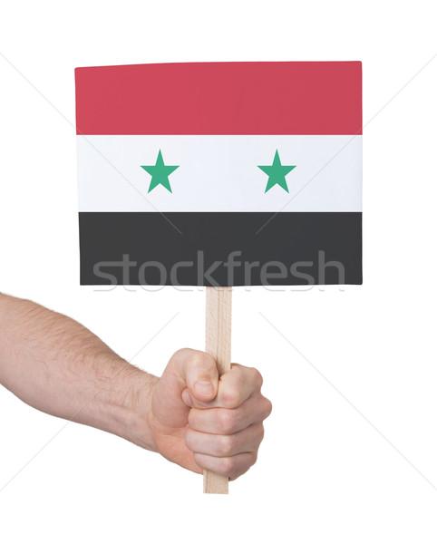 Mão pequeno cartão bandeira Síria Foto stock © michaklootwijk