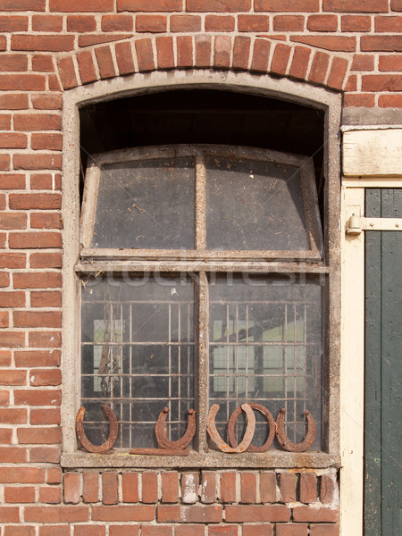 Horseshoes in front of a window Stock photo © michaklootwijk